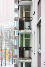 The Facade Of A Residential Building, White Wall, Windows And Unglazed Balconies In The Big City, Snowfall In Winter. Kiev, Europe. High Quality Photo
