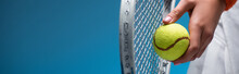 Cropped View Of Sportive Young Woman Holding Tennis Racket And Ball While Playing On Blue, Banner