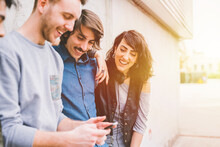 Group Of Multiethnic Friends Millennials Using Smartphone
