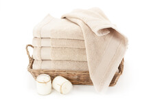 Bath Towels In A Wicker Basket.