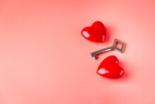Key With A Heart As A Symbol Of Love. Valentines Day Background. Greeting Card With Red Heart On Pink Background