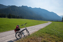 Bike Tour In Alpine Landscape With A Folding Bicycle, Upper Bavaria