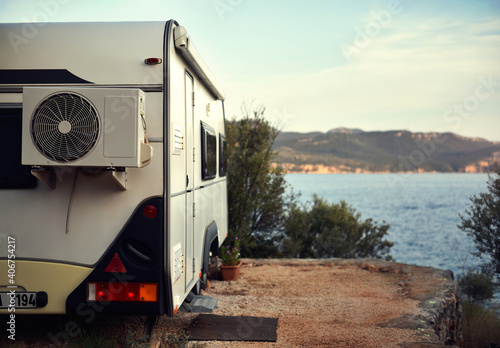 caravan is stand on camping place by sea bay Fototapete