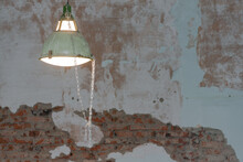 An Old Ceiling Lamp On The Old Brick Wall Background.