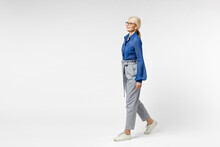 Full Length Side View Blonde Pensive Happy Successful Employee Business Woman 40s In Blue Classic Shirt Gray Pants Glasses Formal Clothes Walking Going Isolated On White Background Studio Portrait.
