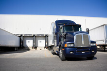 Blue Tranport Truck Docking In Warehouse
