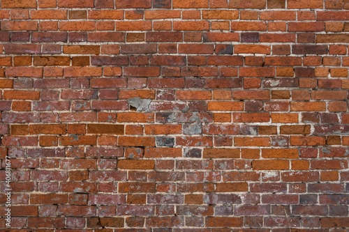 brick red wall. background of a old brick house. Fototapeta