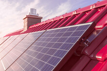 Solar Panels Or Photovoltaic Power Plant On A Red Tiled Roof, Renewable Sun Power Energy