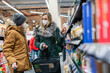 canvas print picture - Family shopping in supermarket during covind19 pandemic