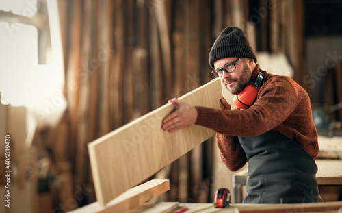 Tela brutal male carpenter working in  workshop
