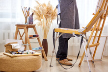 Cropped Photo Of Artist Male At Work In Studio, Necessary Equipment Tools And Materials Need For Creation Of Paintings In Light Room