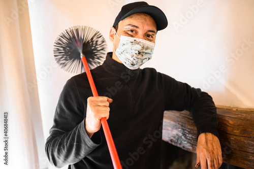 Tablou Canvas Young chimney sweep portrait in a house wearing a mask due to coronavirus emerge