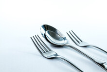 Two Forks And Two Spoons, Isolated On White