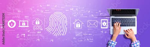 Obraz Fingerprint scanning theme with woman using a laptop computer - fototapety do salonu