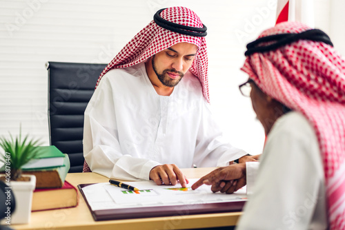 Canvas Print Successful of two arab  business people working with laptop computer