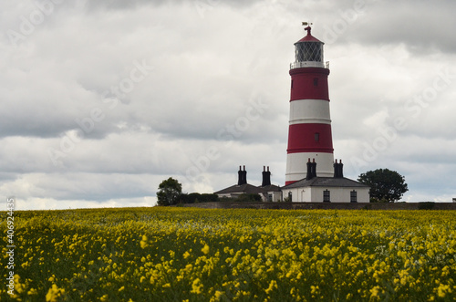 Happisburgh lighthouse against cloudy sky. Fotobehang