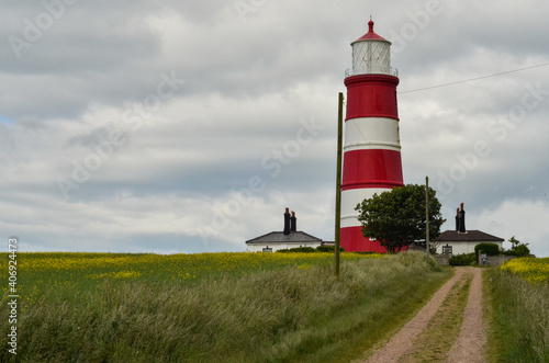 Fotografía Happisburgh lighthouse against cloudy sky.