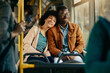 Happy African American couple relaxing while commuting by bus.