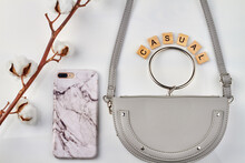 Casual Fashion Concept. Violet Pouch For Women And Glorious Cellphone On White Background.