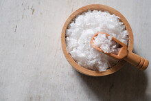Flower Of Salt, Is A Salt That Forms As A Thin, Delicate Crust On The Surface Of Seawater In The Wooden Scoop And Wooden Bowl On Wooden Background.