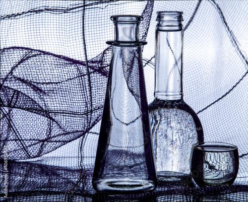 Fototapeta Abstract still life with glass bottles obraz