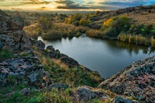 Beautiful Small River Among Large Stones And Green Vegetation On The Hills In Ukraine