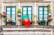 Portuguese Flag On The Balcony At House In Braga, Portugal