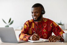 Distance Learning. Happy Black Millennial Guy Study Online With Laptop And Headset
