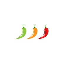 Three Hot Chili Peppers. Green, Orange And Red Jalapeno Peppers.