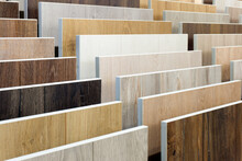 Laminate Background. Samples Of Laminate Or Parquet With A Pattern And Wood Texture For Flooring And Interior Design. Production Of Wooden Floors..