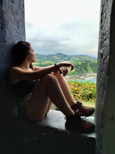 Beautiful Girl Looking Down In A Viewpoint
