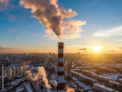 Winter city landscape. Industrial pipe with smoke. Fotobehang
