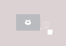 A Set Of Laptop And Power Adapter Set, A Cute Cat Head Sticker On Top Of The Computer, Workplace, Isolated Objects On Plain Background