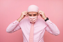 Man With Scarf And Pink Mask, In Solidarity With Cancer