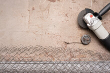 Metal Pieces, Circular Saw, Fencing Net And Meter On The Gray Background With Copy Space.