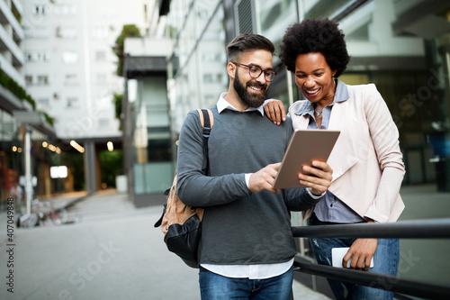 Fototapeta Portrait of happy business friends enjoying the break from meeting obraz na płótnie