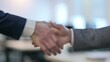 Close up of Two Businessmen Shaking Hands