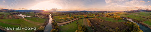 Fotografie, Obraz Spectacular aerial panorama of river flowing through fields at sunset