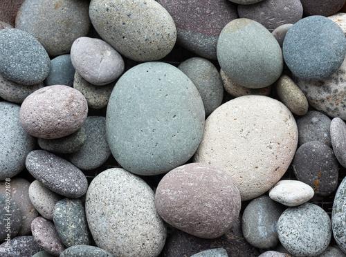 Fototapeta round pebbles river texture Boulders backdrop