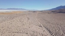 Aerial Fly Over California Salt Flat With US Military Jet Flying By