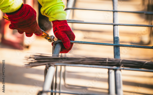 Fotografering Construction worker Making Reinforcement steel rod and deformed bar with rebar at construction site