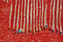 Aerial View Of Woman Picking Red Chilies Using Large Bowls To Sort The Chilli Peppers At This Farm Before They Were Delivered To Spice Companies To Be Made Into Powder In Bogura, Bangladesh.