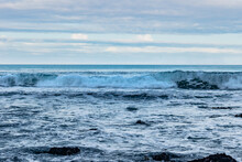 Lowlight Panorama Of Powerful Wave Breaking  In Landscape Scenery Of Atlantic Ocean