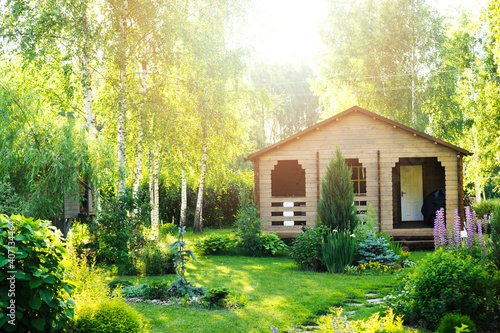 Fotografering small wooden country house view in summer