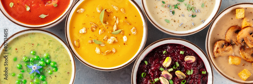 Fototapeta Vegan soup panoramic banner. A variety of vegetable soups, shot from above, flat lay obraz