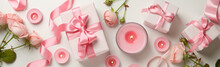 Concept Of Valentine's Day With Roses, Gift Boxes And Candles On White Background