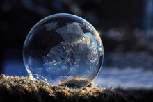 Frozen Soap Bubble With Ice Crystals At Sunlight