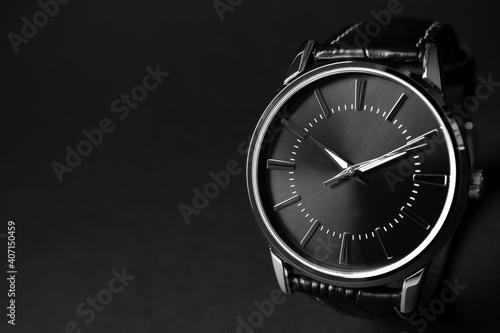 Slika na platnu Luxury wrist watch on black background, closeup. Space for text