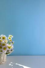 A Basket Of White Wild Chrysanthemum Flowers On Blue Background