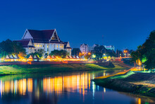 Light On The Nan River With Court Phitsanulok Province Building At The Nan River And The Park At Night In Phitsanulok, Thailand.